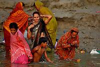 Indian women taking bath in Ganga at Varanasi, Uttar Pradesh, India.