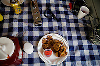 A plate of Rocky Mountain Oysters wait on a table at the Testicle Festival at the Rock Creek Lodge in Clinton, MT.  The Rock Creek Lodge in Clinton, MT, has hosted the annual Testicle Festival since the early 1980s.  The four day festival and party revolves around the consumption of so-called Rocky Mountain Oysters, which are deep-fried bull testicles.