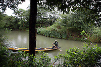 A man paddles a boat through the Xixi wetlands which lie in the west of the city of Hangzhou. This is China's 'first national wetland park,' dubbed as such to act as a role model to all other wetlands in China and to supposedly show how to effectively manage and restore wetlands, notably urban wetlands. Zhejiang Province. China. 2010