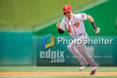 14 May 2016: Washington Nationals outfielder Bryce Harper hustles to third during the first game of a double-header against the Miami Marlins at Nationals Park in Washington, DC. The Nationals defeated the Marlins 6-4 in the afternoon matchup.  Mandatory Credit: Ed Wolfstein Photo *** RAW (NEF) Image File Available ***