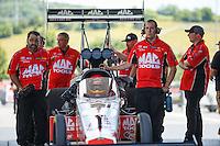Jun 19, 2016; Bristol, TN, USA; Crew members with NHRA top fuel driver Doug Kalitta during the Thunder Valley Nationals at Bristol Dragway. Mandatory Credit: Mark J. Rebilas-USA TODAY Sports