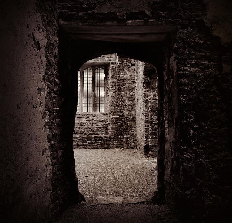 Doorway in medieval castle ruins. Beupre Castle, Wales