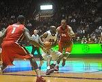 Ole Miss guard Chris Warren (12)  drives the lane past Georgia's Trey Tompkins (33) at the C.M. &quot;Tad&quot; Smith Coliseum in Oxford, Miss. on Saturday, January 15, 2011. Georgia won 98-76.  (AP Photo/Oxford Eagle, Bruce Newman)