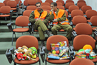 Israeli soldiers wait for patients at a centre where traumatised civilians can get treatement. Israeli forces began an air offensive against Hamas in the Gaza Strip on 27/12/2008, which quickly escalated into an offensive by land, sea and air, in retaliation against Palestinian rockets fired into Israel. After eight days of bombardment, leaving over 400 Palestinians and four Israelis dead, Israeli tanks entered Gaza on 04/01/2009...