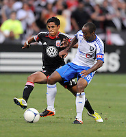 Montreal Impact midfielder Collen Warner (18) goes against D.C. United midfielder Andy Najar (14) D.C. United defeated Montreal Impact 3-0 at RFK Stadium, Saturday June 30, 2012.