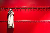 One jacket hanging on hook in minimalist modern cloakroom at Arken Museum of Modern Art, nr Copenhagen, Denmark