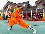 Shaolin Kung Fu student with a broad sword performing at the opening ceremony of Zhengzhou International Wushu Fetival in DengFeng, Henan, China 2014