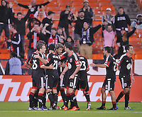 Nick DeLeon (18) of D.C. United celebrates with teammates his score.  The Philadelphia Union tied D.C. United 1-1, at RFK Stadium, Saturday October 12 , 2013.