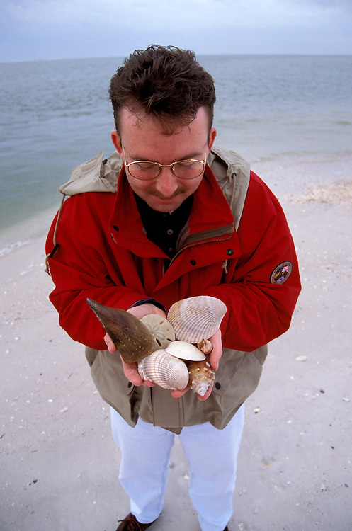 FL: Florida Everglades National Park,.Seashore, beach, shelling near Marco, Model released..Photo Copyright: Lee Foster, lee@fostertravel.com, www.fostertravel.com, (510) 549-2202.Image: flever231