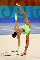 Irina Tchachina of Russia turns pivot (trunk in horizontal) with hoop during All-Around final at 2004 Athens Olympic Games on August 29, 2006 at Athens, Greece. Irina won silver in the All-Around final. (Photo by Tom Theobald)