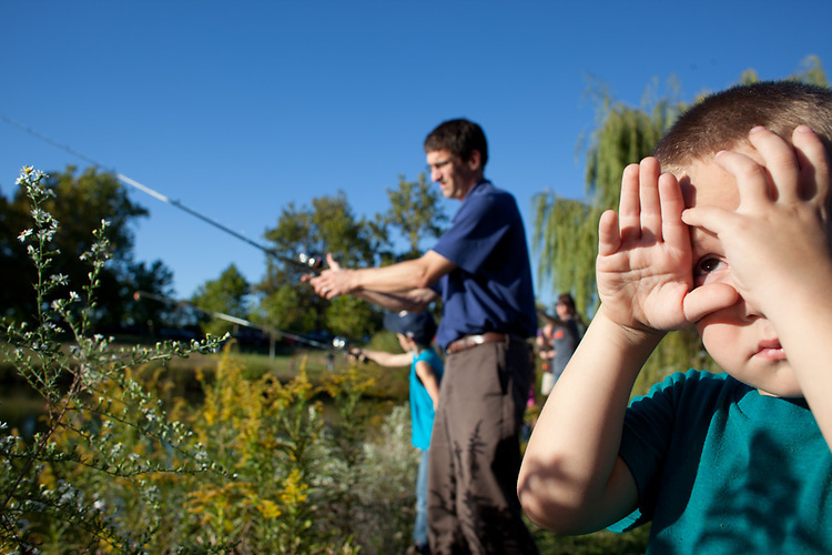 My younger son, age four, was a less-than enthusiastic participant in his brother's school fishing outing.