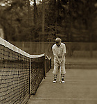 A golfer practices his putting on a tennis court