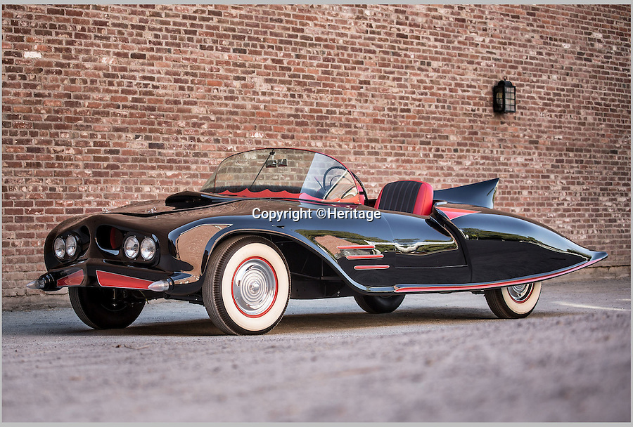 BNPS.co.uk (01202 558833)<br /> Pic: Heritage/BNPS<br /> <br /> ***Plase Use Full Byline***<br /> <br /> The original car.<br /> <br /> The world's first Batmobile has emerged for sale for a whopping &pound;300,000 after being rescued from a field where it spent almost 50 years languishing.<br /> <br /> Batman's famous car was built more than 50 years ago from a 1956 Oldsmobile 88 that was converted to look just like the one from the comic books which made the Caped Crusader famous.<br /> <br /> It is a far cry from the Batmobile that appeared in Christopher Nolan's modern remakes of Batman.<br /> <br /> But as the first Batmobile ever built, experts at Dallas-based Heritage Auctions say it could sell for as much as $500,000 - more than &pound;300,000.