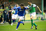 Hibs v St Johnstone...28.09.11   SPL Week.Francisco Sandaza holds off Ian Murray.Picture by Graeme Hart..Copyright Perthshire Picture Agency.Tel: 01738 623350  Mobile: 07990 594431