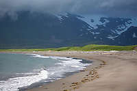Ominous dark storm clouds over the Aleutian mountain range along the coast of Katmai National Park, Alaska Peninsula, southwest Alaska.