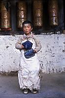 Boy prostrating at temple, Jyekundo, Kham, Tibet, 2005
