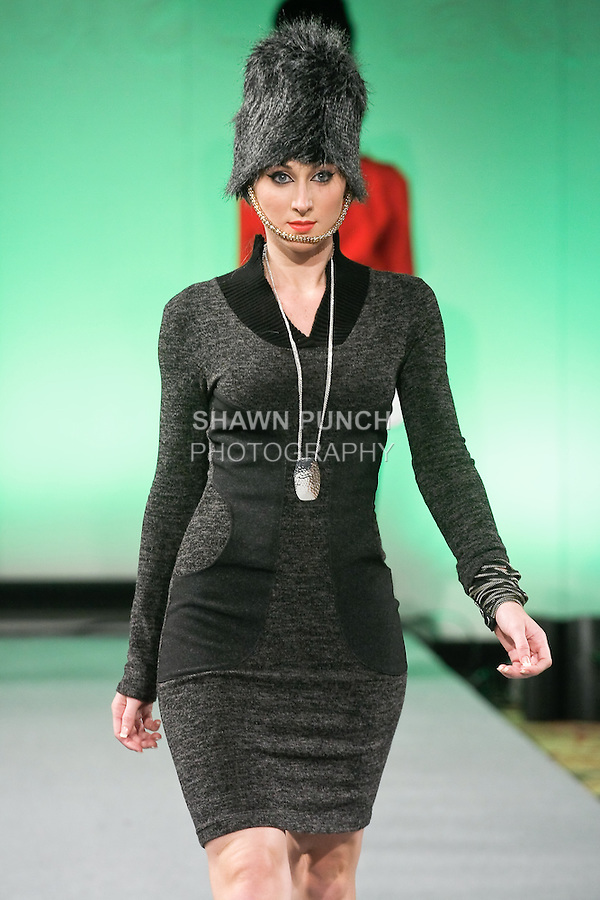Model walks runway in an outfit from the Sandra Baquero Fall Winter 2012 collection, by Sandra Baquero, during Couture Fashion Week New York Fall 2012.