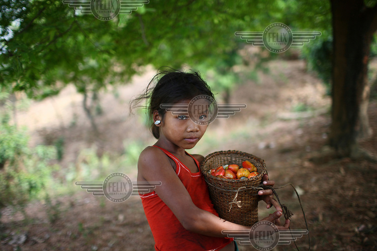 Mro (Mru) child in her village of Thanchi in the Chittagong Hill Tracts.