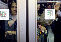 Passengers squeezed onto full trains are pushed against the glass during morning rush hour, Shinjuku, Tokyo. With up to 4 million passengers passing through it every day, Shinjuku station, Tokyo, Japan, is the busiest train station in the world. The station was used by an average of 3.64 million people per day.  That&rsquo;s 1.3 billion a year.  Or a fifth of humanity. Shinjuku has 36 platforms, and connects 12 different subway and railway lines.  Morning rush hour is pandemonium with all trains 200% full. <br /> <br /> Photo by Richard jones / sinopix