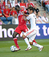 Toronto midfielder Nathan Sturgis (11) shoves Chicago midfielder Dominic Oduro (8).  The Chicago Fire defeated Toronto FC 2-0 at Toyota Park in Bridgeview, IL on August 21, 2011.