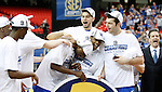Teammates congratulate Darius Miller as he is named SEC Tournament Most Valuable Player and to the SEC All-Tournament team after the win over Florida in the SEC Tournament, played at the Georgia Dome, Sunday, March 13, 2011.   Photo by Latara Appleby | Staff