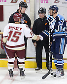 Joe Whitney (BC - 15) and Tanner House (Maine - 29) shake hands while meeting with referees Kevin Keenan and Jeff Bunyon. - The Boston College Eagles defeated the visiting University of Maine Black Bears 4-0 on Friday, November 19, 2010, at Conte Forum in Chestnut Hill, Massachusetts.