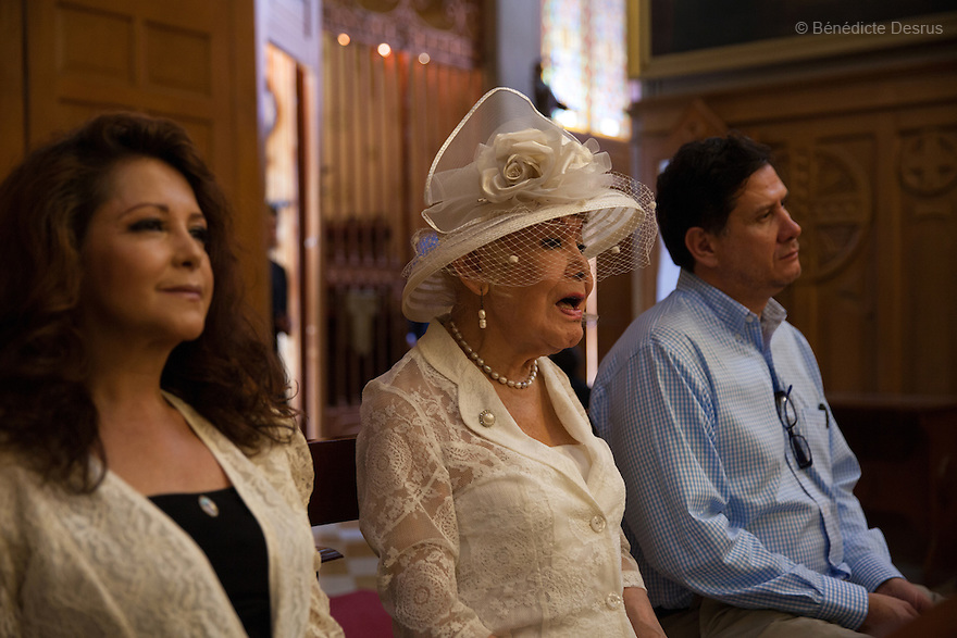 """August 8, 2015 - Mexico, Mexico City - Samantha is accompanied to her baptism byclose friends and hergodfatherat the 'Sagrada Familia church' in Mexico City. Samantha Flores is an 83-year-old transgender woman from Veracruz, Mexico. She is a prominent social activist for LGBTQI rights and is the founder of the non-profit organization """"Laetus Vitae"""", a day shelter for elderly gay people in Mexico City. Senior citizens in general are many times prone to neglect and abandonment by their families, leaving them all but invisible. Their plight can be even worse if they are homosexual. Photo credit: Bénédicte Desrus"""