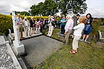 Descendents of John Caulfield gather around his grave behind Saint Patrick's Church in Granlahan, County Roscommon, Ireland on Tuesday, June 25th 2013. (Photo by Brian Garfinkel)