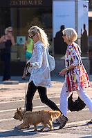 Women walking a dog in Max-Joseph-Platz, Munich, Bavaria, Germany