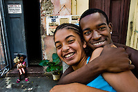 A young Cuban boy embraces a girl on the street of Santiago de Cuba, Cuba, 29 July 2008. About 50 years after the national rebellion, led by Fidel Castro, and adopting the communist ideology shortly after the victory, the Caribbean island of Cuba is the only country in Americas having the communist political system. Although the Cuban state-controlled economy has never been developed enough to allow Cubans living in social conditions similar to the US or to Europe, mostly middle-age and older Cubans still support the Castro Brothers' regime and the idea of the Cuban Revolution. Since the 1990s Cuba struggles with chronic economic crisis and mainly young Cubans call for the economic changes.