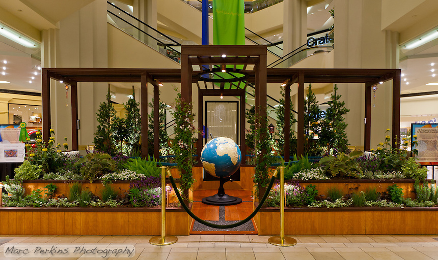 "A head-on view of Orange Coast College's Ornamental Horticulture Club's first-place winning garden installation at the 2012 South Coast Plaza Spring Garden Show in Costa Mesa, CA.  The theme for the show was ""healing gardens"", and the OCC team installed a ""garden for the visually impaired.""  The garden's centerpiece is a 1957 restored globe for the blind, with the world geography in exaggerated height to be sensed by the touch of blind people; the locations of plants in the garden was indicated in braille on the globe.  This picture was taken Thursday April 27, 2012 at ~9pm, less than 48 hours after my in-progress pictures."
