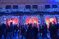 Shoppers view Christmas windows of Saks Fifth Avenue on Fifth Avenue in Midtown Manhattan in New York on Tuesday, December 13, 2016. (© Richard B. Levine)