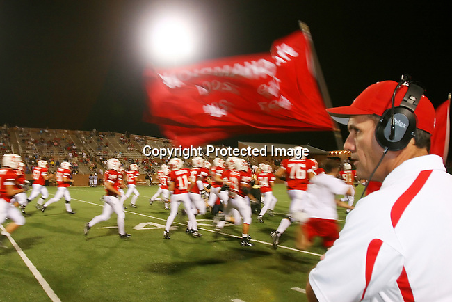 Katy High School head coach Gary Joseph watches his team prepare for the second half.  Coach Joseph led the team to an undefeated season and a Texas 5A state title in 2007.