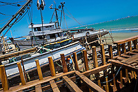 Ecuadorian shipbuilding workers repair traditional wooden fishing vessels in an artisanal shipyard on the beach in Manta, Ecuador, 8 September 2012. The construction process takes 3-4 months to complete, depending on the ship size and purpose (fish capture methods). Although a wooden boat tends to be more stable on the sea and less expensive to build (up to $0.5 million USD), it needs a maintenance every 2 years, while a fiberglass-made boat, costing almost double the wooden one, may serve 5-6 years without any repairs. The shipyard produces 6-8 vessels every year.