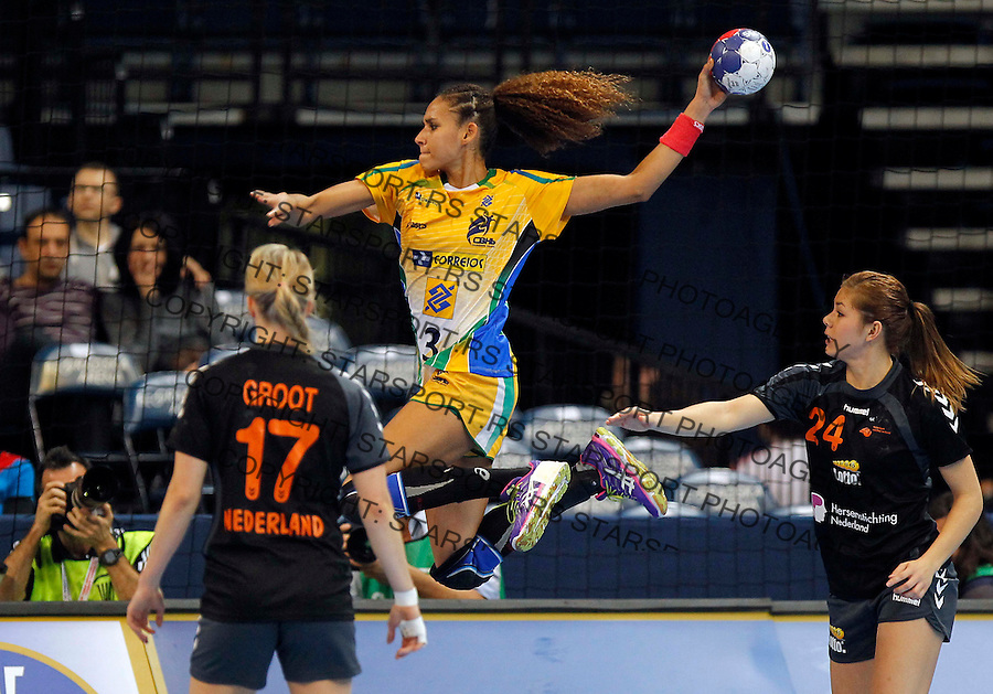 BELGRADE, SERBIA - DECEMBER 16: Alexandra Nascimento (C) jump to score near Martine Smeets (R) and  Cornelia Groot (L) of Netherlands during the 2013 World Women's Handball Championship 2013 match between Brazil v Netherlands at Kombank Arena Hall on December 16, 2013 in Belgrade, Serbia. (Photo by Srdjan Stevanovic/Getty Images)
