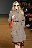 Aline Weber walks runway in an outfit from the Marc by Marc Jacobs Fall/Winter 2011 collection, during New York Fashion Week, Fall 2011.