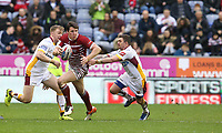 Wigan Warriors' Joel Tomkins watched by Huddersfield Giants' Danny Brough (right) and Aaron Murphy (left) <br /> <br /> Photographer Stephen White/CameraSport<br /> <br /> Betfred Super League Round 5 - Wigan Warriors v Huddersfield Giants - Sunday 19th March 2017 - DW Stadium - Wigan<br /> <br /> World Copyright &copy; 2017 CameraSport. All rights reserved. 43 Linden Ave. Countesthorpe. Leicester. England. LE8 5PG - Tel: +44 (0) 116 277 4147 - admin@camerasport.com - www.camerasport.com