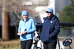 WILMINGTON, NC - MARCH 19: North Carolina's Jose Montano (BOL) (left) consults with head coach Andrew Sapp (right) before teeing off on the Ocean Course fourth hole. The first round of the 2017 Seahawk Intercollegiate Men's Golf Tournament was held on March 19, 2017, at the Country Club of Landover Nicklaus Course in Wilmington, NC.
