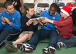 St Johnstone players visit Fairview School in Perth.....19.12.13<br /> Sanil Jahic and Nigel Hasselabink pictured playing pass the parcel with Andrew Davies (centre)<br /> Picture by Graeme Hart.<br /> Copyright Perthshire Picture Agency<br /> Tel: 01738 623350  Mobile: 07990 594431