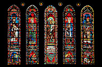 Medieval Window of the North Transept of the Gothic Cathedral of Chartres, France- Circa 1235. A UNESCO World Heritage Site. The panels depict from left to right - 1. Melchizedek with Nebechadnezzar praying to a pagan idol below 2. King David with his harp with Saul dying on his own sword below 3. Saint Anne carrying the infant Mary with The arms of the Royal House of France below 4. King Solomon with Jeroboam worshipping the idols of Dan and Bethel below, 5. Aaron with Pharaoh falling from his horse below,