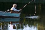 A Victorian dressed man fishing
