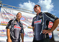 Sep 5, 2016; Clermont, IN, USA; NHRA pro stock driver Greg Anderson (left) with teammate Jason Line during the US Nationals at Lucas Oil Raceway. Mandatory Credit: Mark J. Rebilas-USA TODAY Sports