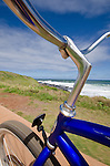 Bicycling on a bike path along the coast in Kapa'a, Kauai, Hawaii