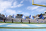"""30 November 2013: Duke cheerleaders run flags across the endzone spelling """"Duke"""" after a touchdown. The University of North Carolina Tar Heels played the Duke University Blue Devils at Keenan Memorial Stadium in Chapel Hill, NC in a 2013 NCAA Division I Football game. Duke won the game 27-25."""
