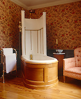 The luxurious atmosphere of a bygone age is recreated in this opulent bathroom with its Victorian bath and shower