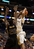 Omondi Amoke battles for the shot against Quincy Pondexter. The Washington Huskies defeated the California Golden Bears 79-75 during the championship game of the Pacific Life Pac-10 Conference Tournament at Staples Center in Los Angeles, California on March 13th, 2010.