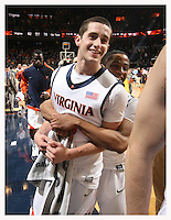 Virginia's Sammy Zeglinski, left, and Jontel Evans, right, celebrate the 82-75 win over Georgia Tech during an ACC college basketball game Wednesday Jan. 13, 2010 in Charlottesville, Va.   (Photo/Andrew Shurtleff)