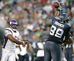 Seattle Seahawks Alan Branch deflects a pass thrown by Minnesota Vikings quarterback Donovan McNabb  in the quarter of a pre season game on Saturday August, 2011 at CenturyLink Field in Seattle.   The Vikings beat the Seahawks  20-7. ©2011 Jim Bryant Photo. All Rights Reserved.
