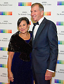 United States Secretary of Commerce Penny Pritzker and her husband, Dr. Bryan Traubert, arrive for the formal Artist's Dinner honoring the recipients of the 39th Annual Kennedy Center Honors hosted by United States Secretary of State John F. Kerry at the U.S. Department of State in Washington, D.C. on Saturday, December 3, 2016. The 2016 honorees are: Argentine pianist Martha Argerich; rock band the Eagles; screen and stage actor Al Pacino; gospel and blues singer Mavis Staples; and musician James Taylor.<br /> Credit: Ron Sachs / Pool via CNP
