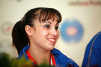 Oct 19, 2006; Aarhus, Denmark; Portrait is of Ferrari of Italy (1st) during interviews after winning women's gymnastics ALL-Around gold at 2006 World Championships Artistic Gymnastics. Photo by Tom Theobald